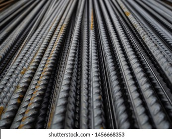 Steel reinforcement folded on the construction site. Rusty steel bars for concrete reinforcement. The texture of the steel reinforcement