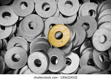 steel ring circle, many metal shining and one gold washers background. Natural photo.