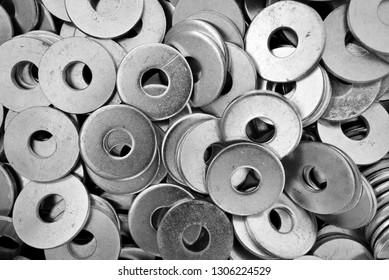 Steel ring circle, metal shining washers background. Natural photo.