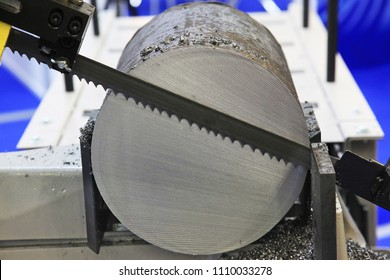 Steel rod cutting by band saw machine