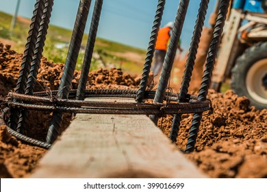 Steel rod used for poles construction with reinforce concrete in a hole in the ground at construction site.
