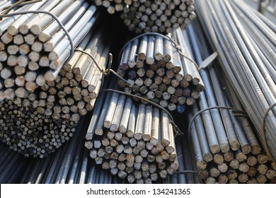Steel rods or bars used to reinforce concrete. abstract macro with shallow depth of field.