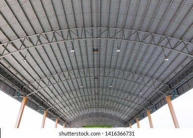 Steel roof structure. Moonlight bulb. Steel structure with roof tiles. Architectural structure of roof. Large roof layout used for industrial plants.