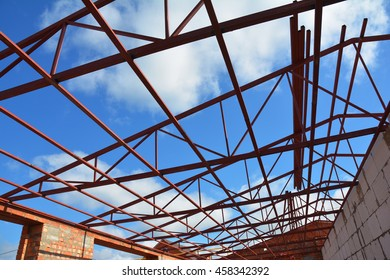 steel roof trusses details with clouds sky background steel roof trusses sitting on concrete pole - Metal Roof Trusses