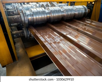 Steel Roofing Forming Machine.Industrial machine for metel sheet roof coils cut.