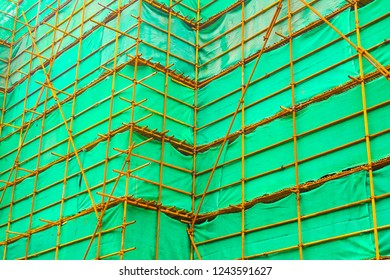 Steel scaffolding with a green curtain in a construction site in Shanghai, China