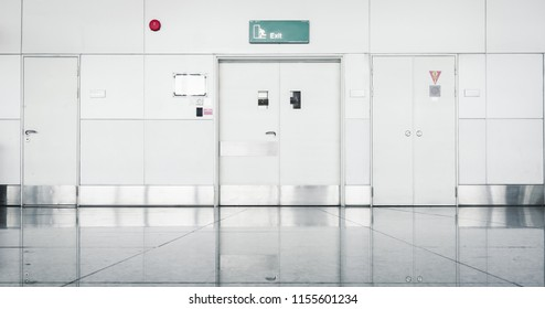 Steel Security Door and Fire Protection System in Airport Terminal, Emergency Exit Gate Doorway and Alarm Fire Prevention. Architecture of Steel Doors and Corridor Flooring in Lounge Boarding Gate