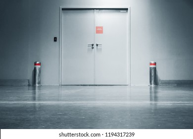 Steel Security Door and fire Protection System in Department Store, Entrance Gate Doorway and Guard Post of Storehouse Workshop. Architecture of Steel Doors and Corridor Flooring in Factory Warehouse.
