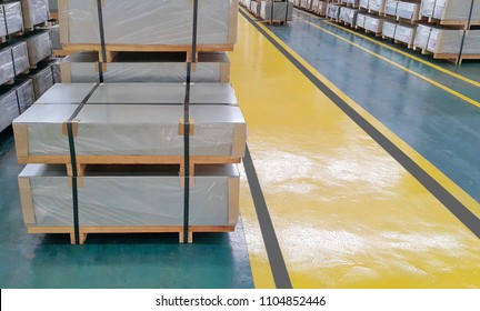 Steel sheet Sheared cutting Plate metal strap put near the safety walkway in factory warehouse, metal service center