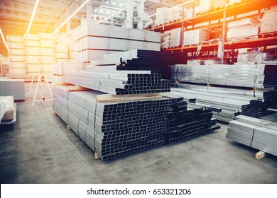 Steel, Shelf with structural materials on the shelves in the building warehouse. high contrast and monochrome color tone.Concept logistics companies and large  warehouse industrial