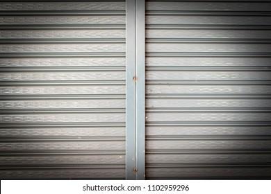 Steel shiny rolling shutter door texture with horizontal lines.
