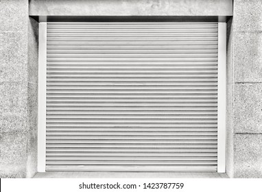 Steel shutter door of warehouse, storage or storefront for background and textured.