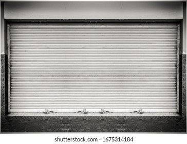 Steel shutter door of warehouse, storage or storefront for metal door background and textured.