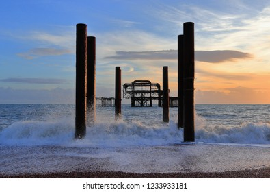 The steel skeleton of Brighton's historic West Pier in the surf. South coast of England, seaside resort Brighton and Hove, East Sussex, United Kingdom.