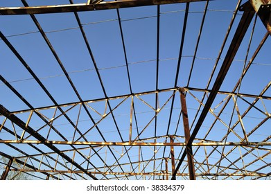 A steel skeleton structure is all that remains of a fire-damaged warehouse building