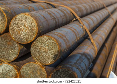 Steel, some round steel bars in the steel bearing outdoor, metal bundled with steel tape, selective focus