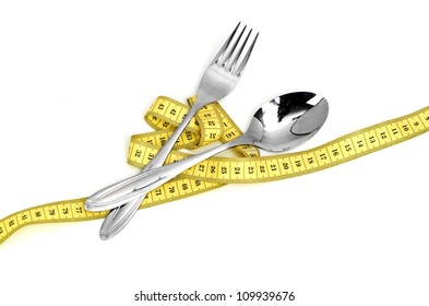 Steel spoon a fork and measuring tape isolated