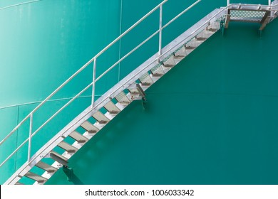 steel stair on  green metal silo,  metal ladder on green chemical container tank