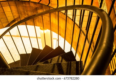 Steel staircase shaped way up the night circle electric orange light