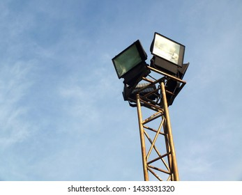 Steel streetlight or lamppost with blue sky background.