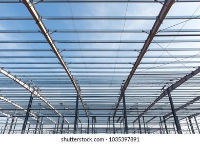 steel structure building closeup against a blue sky