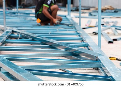 Steel structure industrial building on process with blur worker background