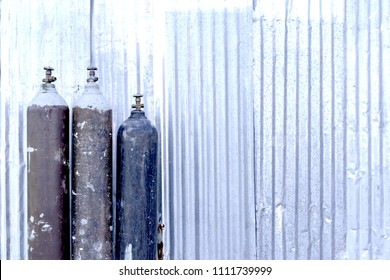 Steel tank filled with carbon dioxide. Placed beside the zinc wall.