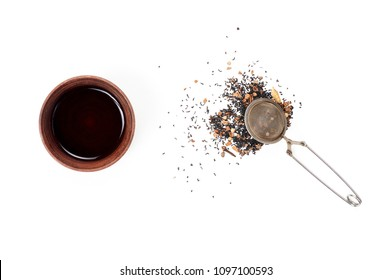 Steel Tea Strainer with Indian black tea with a mix of spices for Masala Chai and cup of tea. Isolated on white background, top view, flat lay, copy space