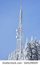 Steel telecommunication tower on heavy snow