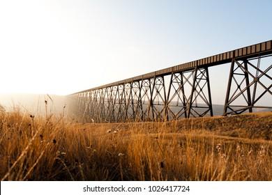 Steel train bridge on a prairie field