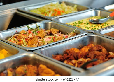 Steel tray filled with food inside the self service Chinese restaurant
