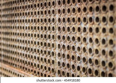 steel tubes of the heat exchanger, the water heater in the boiler as background