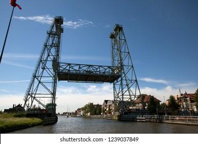 Steel vertical lift bridge in Alphen aan den Rijn over the canal Gouwe