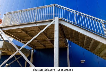 The steel walkway and steps that form teh fire esacpe of a large building