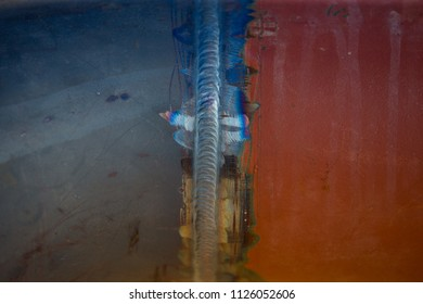 Steel weld joined pipe by arc welding process . rainbow color.with copy space