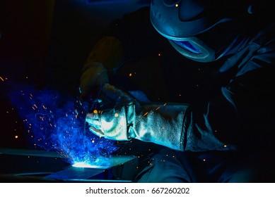 steel welder in factory, craftsman erecting technical steel