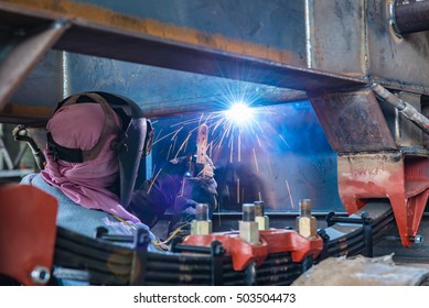 Steel welding of the beam under the truck. Such skillful crafting to joint the high strength steel bar. Picture also shows leaf spring those specially designed for the truck.