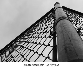 Steel wire fence with corner post grayscale