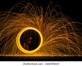 Steel wool light painting as a circle in the dark background