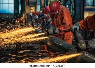 The steel worker is burnishing the steel