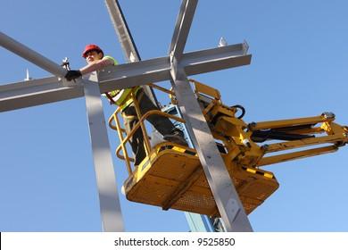 Steel worker on cherry-picker