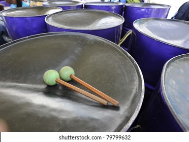 A Steelband player's sticks & pans