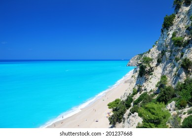 Steep cliffs and large long beach with turquoise sea on the island of Lefkada in Greece