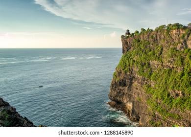 Steep coast at ancient Uluwatu temple in Bali, Indonesia