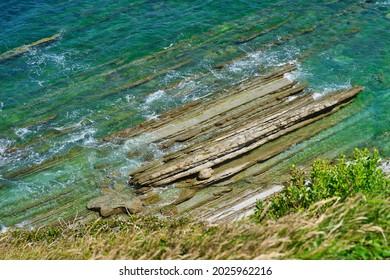 Steep coast with blue sea