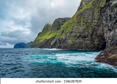 Steep coastline of Faroe islands with spectacular cliffs to the ocean