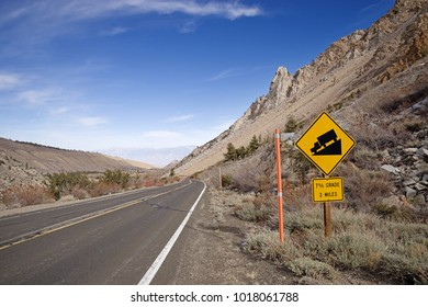 steep downhill with 7 percent grade sign on a mountain road