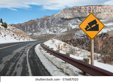 Steep Grade Warning Sign:  Drivers are warned of a steep downhill drive ahead on a mountain road in Bighorn National Forest.