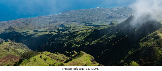 Steep green valley viewpoint leading to blue ocean coast of cape verde island