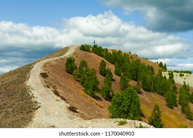 Steep mountain road. Ascent to the Pious Cross, Karabash. End of summer